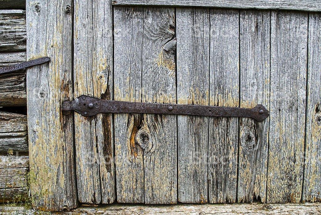 Rusty hinge on an old wooden door stock photo