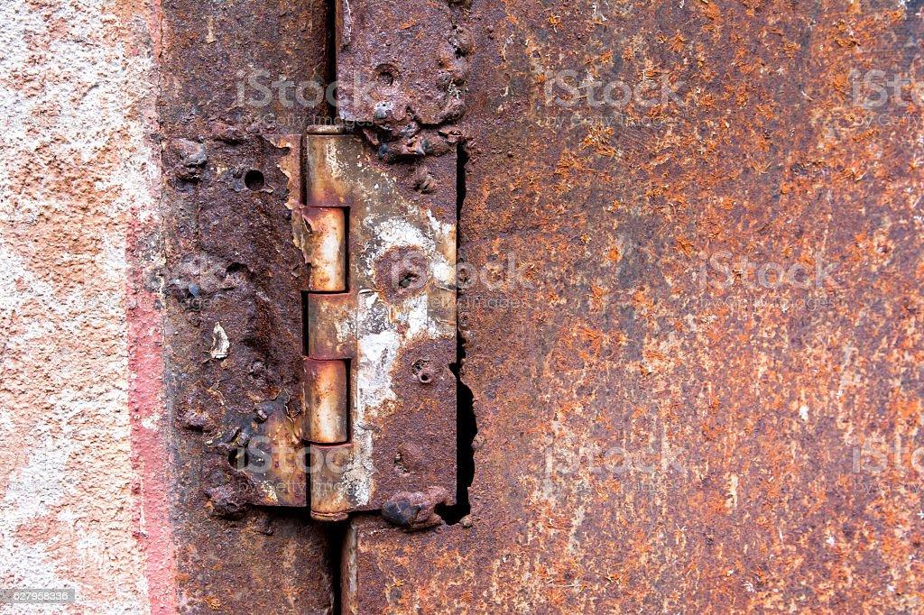 Rusty Metal Door rusty hinge welded steel on a rusty metal door texture stock photo