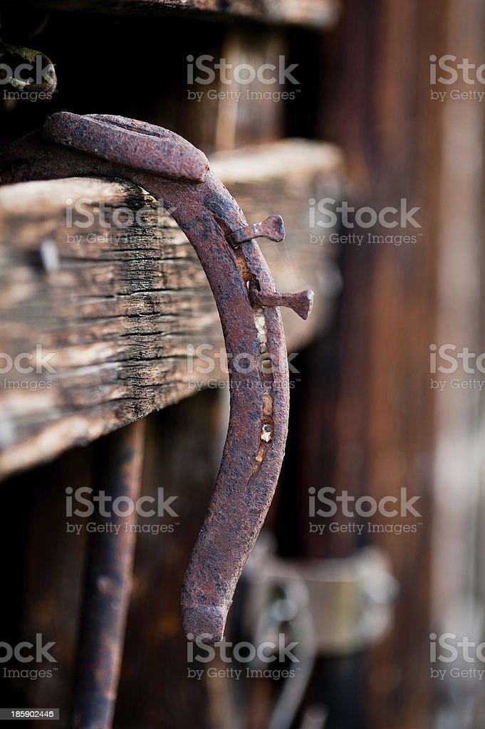 Rusty Horseshoe Hanging in Barn royalty-free stock photo