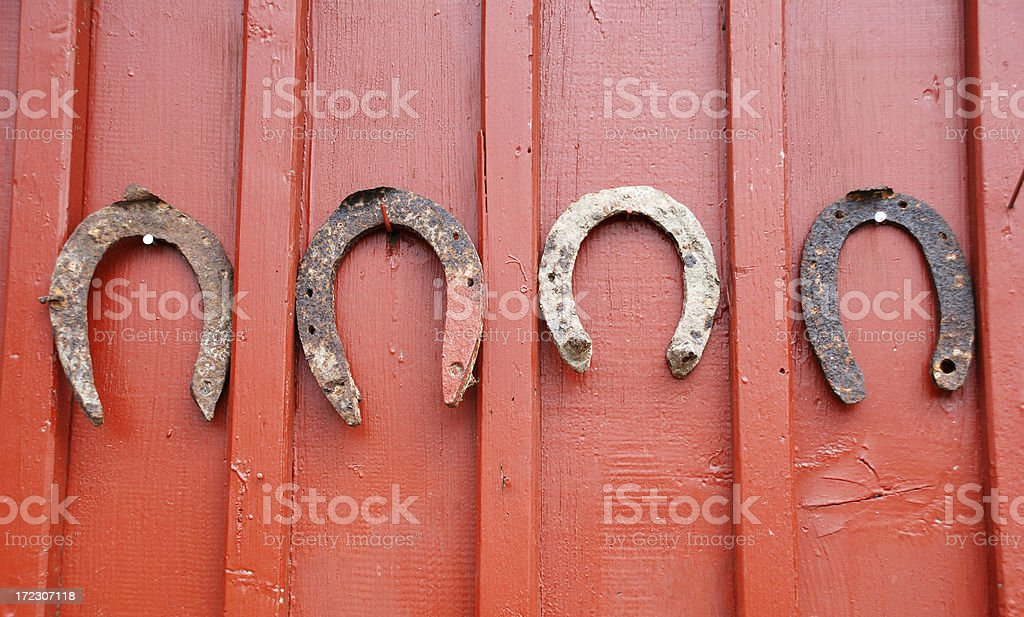 rusty horseshoes on a wooden door royalty-free stock photo