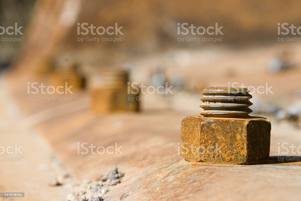 Rusty Industrial Bolt and Nut in Row stock photo