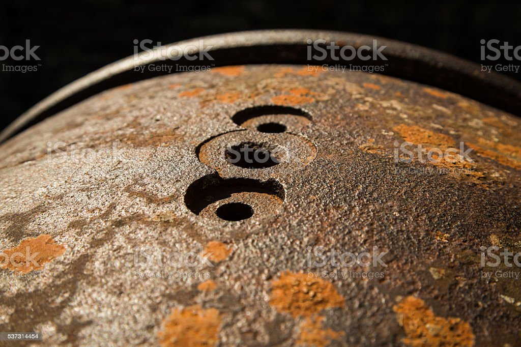 Rusty Industrial Ironwork with Three Drilled Holes stock photo