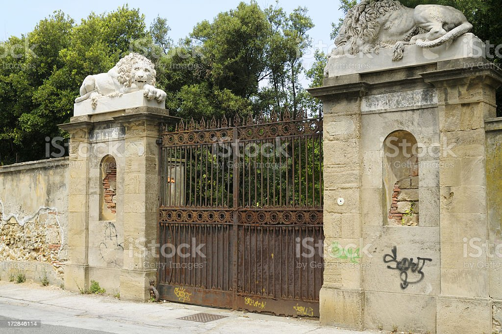 rusty iron gate and lions royalty-free stock photo