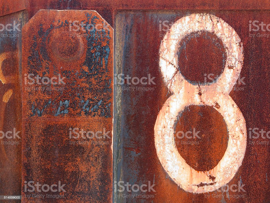 Rusty iron plates with eroded eight stock photo