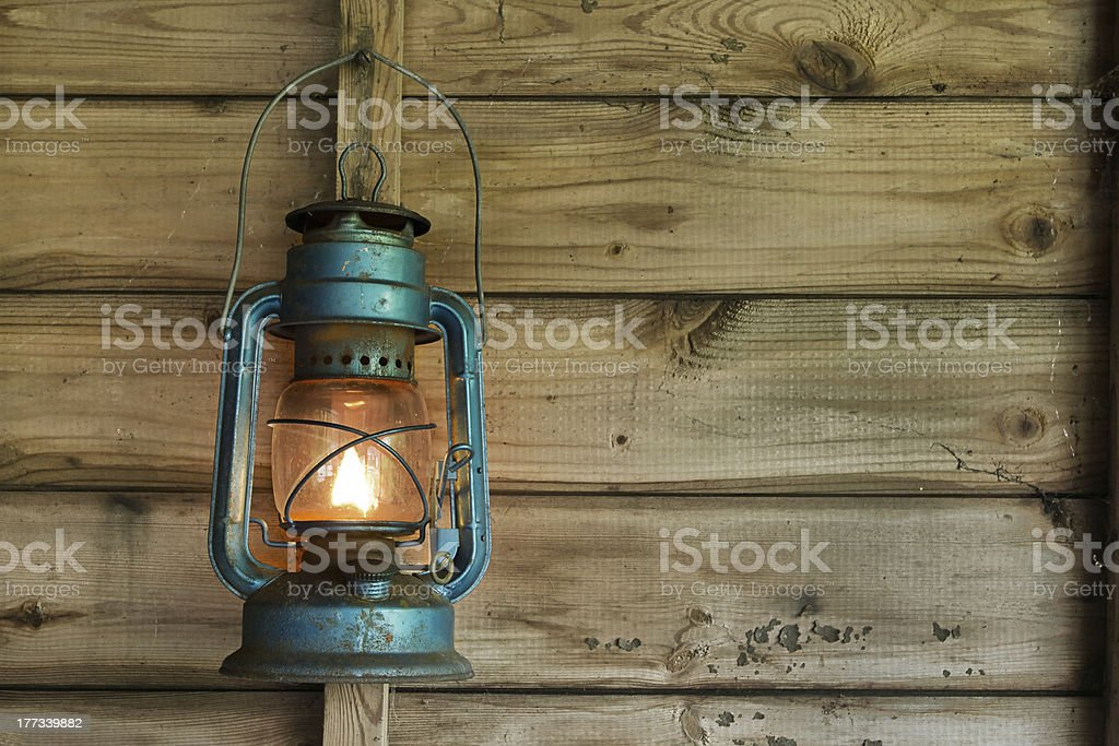 Rusty lantern hanging in a shed stock photo