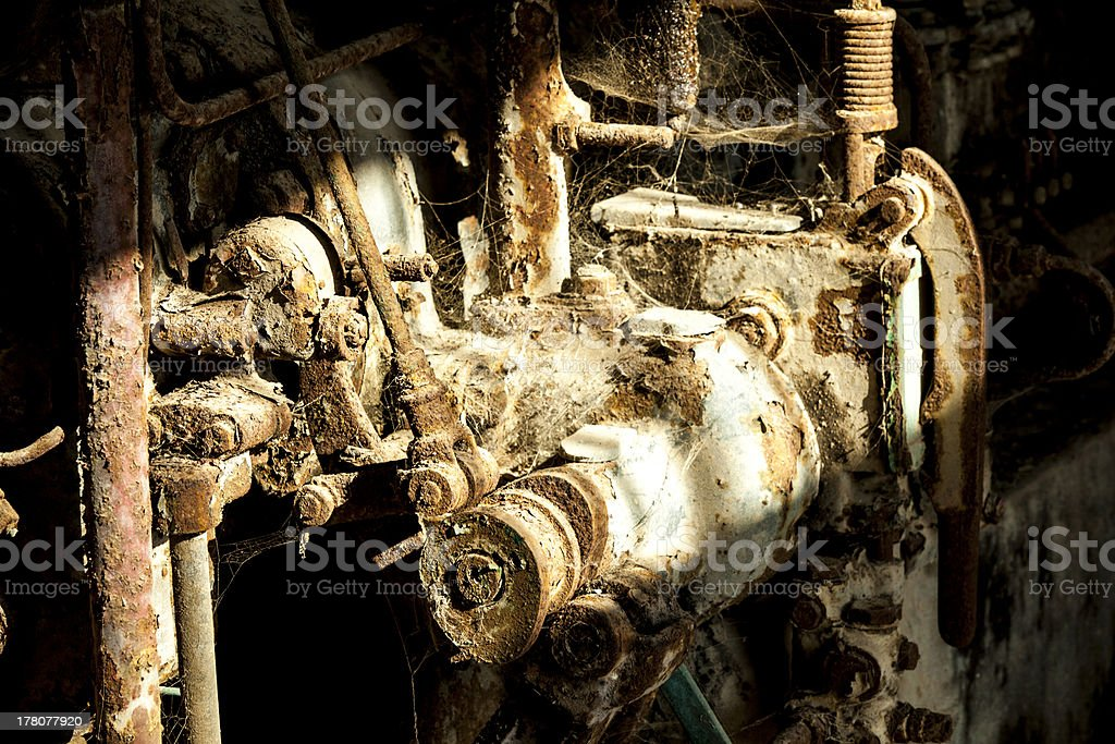 rusty machine in old rotten refinery station stock photo
