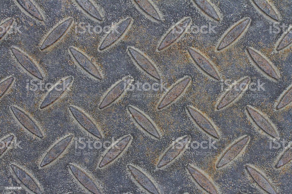Rusty metal background with non slip repetitive pattern royalty-free stock photo