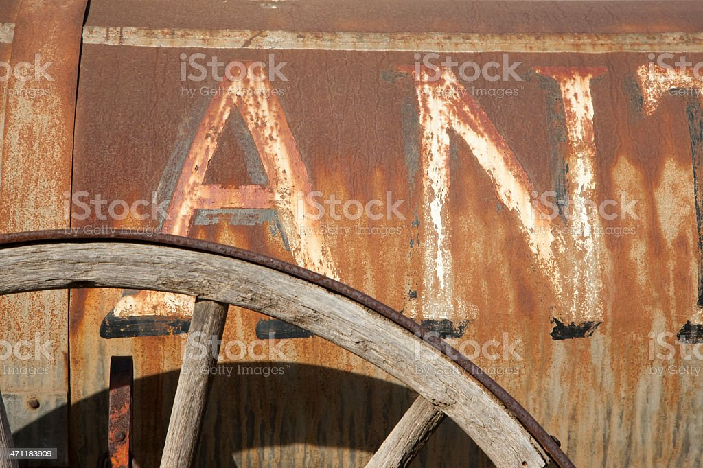 Rusty Metal Building And Wagon Wheel, Wild-West Theme, Stagecoach royalty-free stock photo