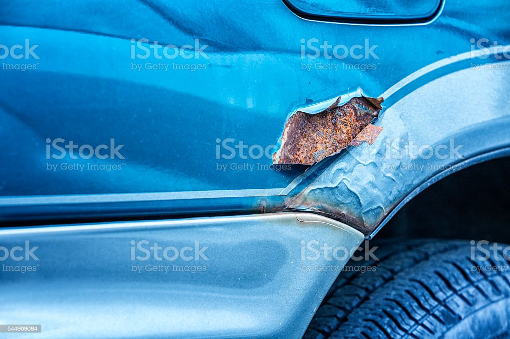 Rusty Metal Corrosion Above Damaged Car Wheel Well stock photo