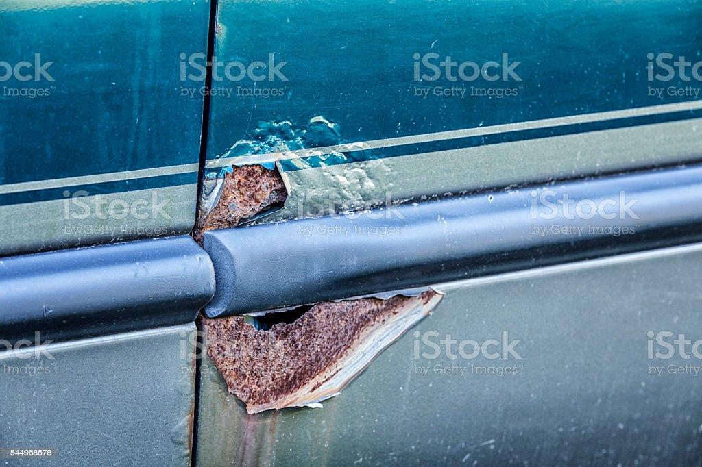 Rusty Metal Corrosion Holes Broken Through Damaged Car Door stock photo