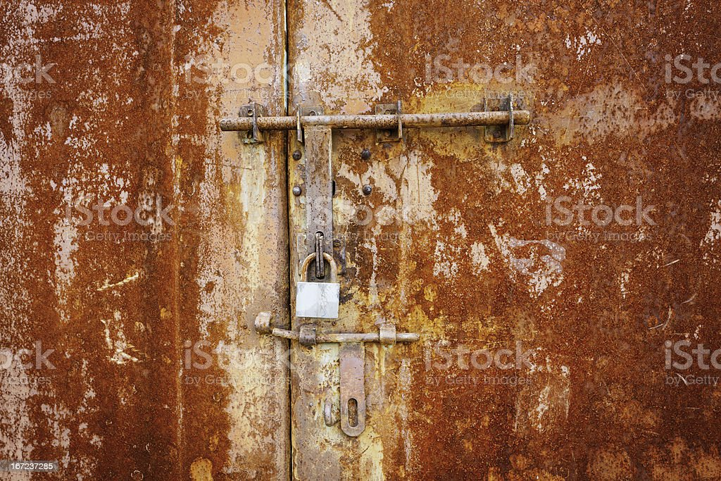 Rusty metal door with lock royalty-free stock photo