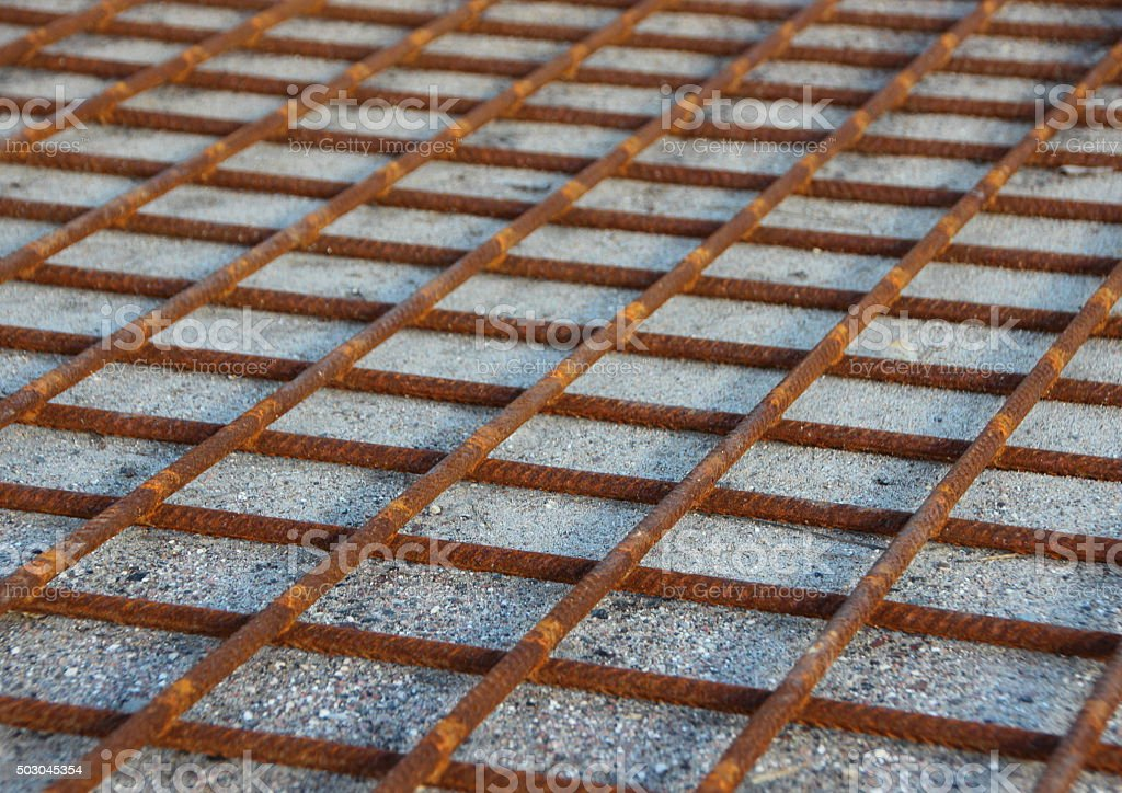 Rusty Metal Foundation Construction Grid on Sand stock photo