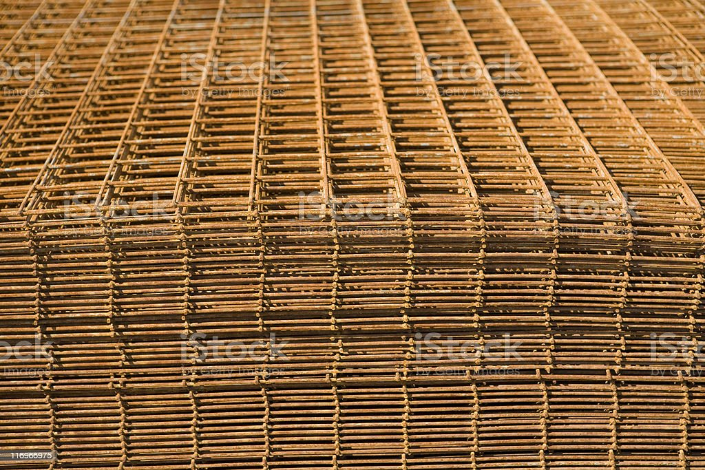 Rusty metal grid fencing at scrap yard royalty-free stock photo