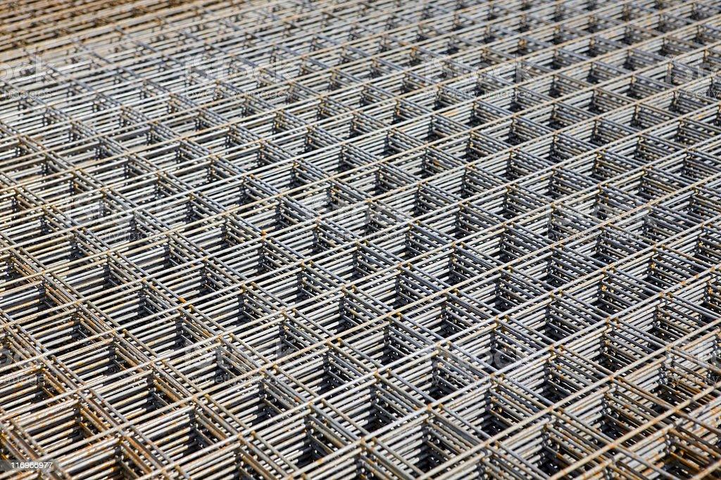 Rusty metal grid fencing at scrap yard royalty-free stock photo