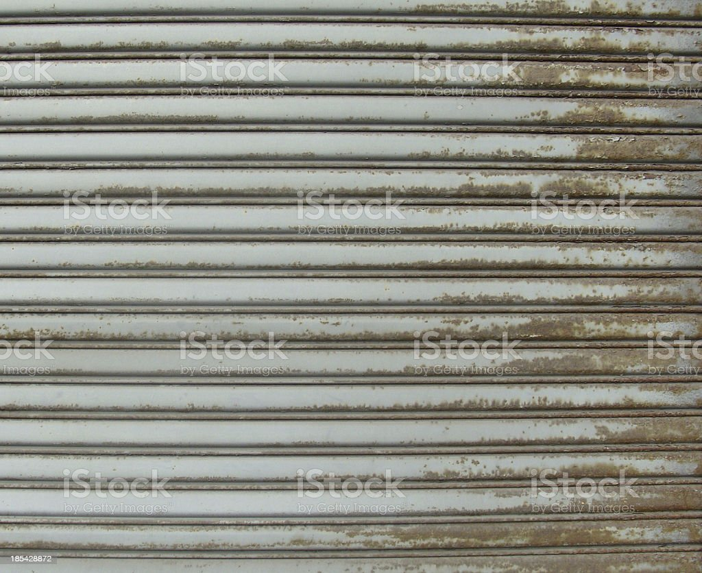 rusty metal store role shutter royalty-free stock photo