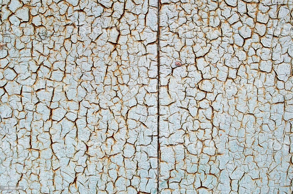 Rusty metal surface which has cracked from age stock photo