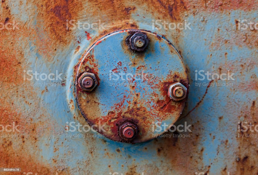 Rusty metal surface with round cover stock photo