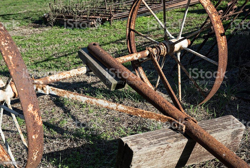 Rusty Metal Wagon Wheels In The Junkyard stock photo