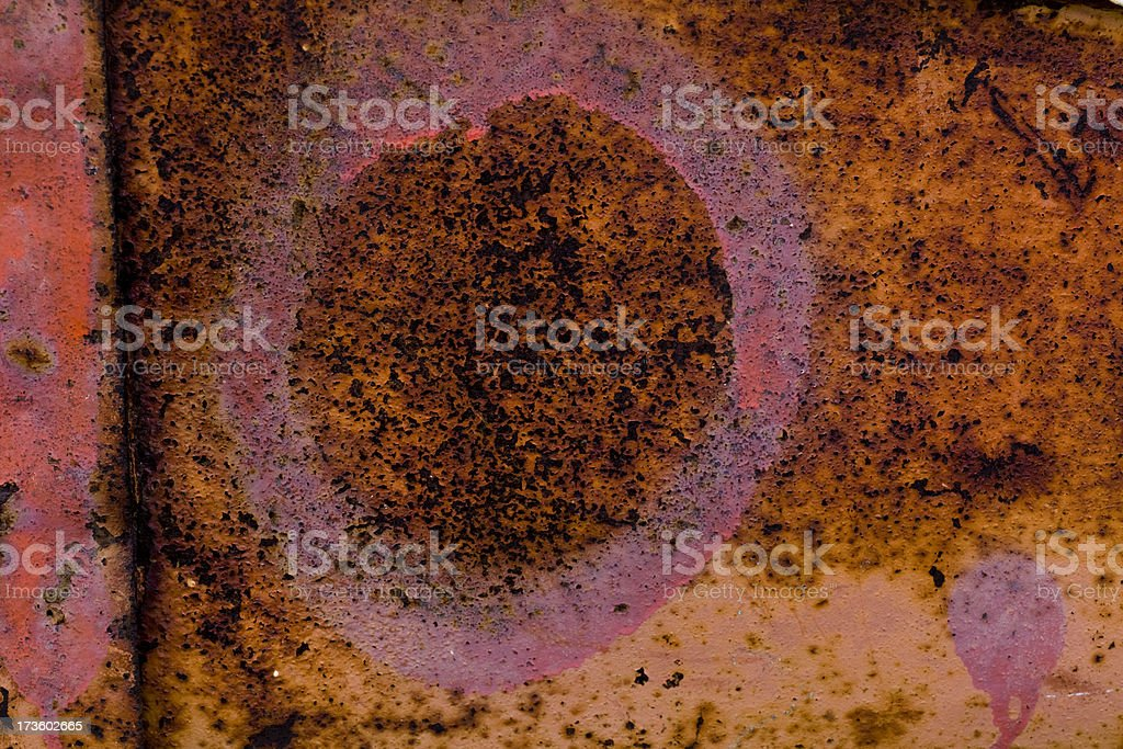 Rusty metal with sprayed paint and letter O royalty-free stock photo