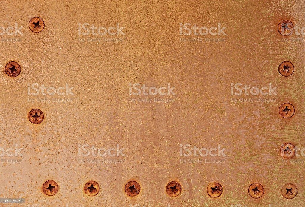 Rusty Metal XXXL Texture with Screws royalty-free stock photo