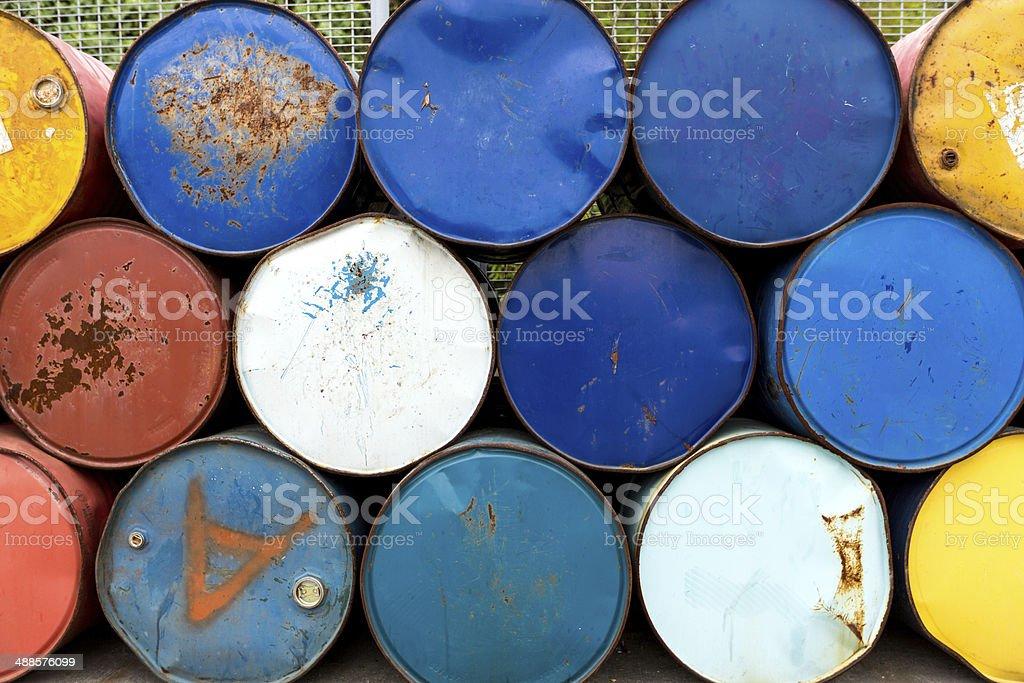 Rusty metall barrels in a row stock photo