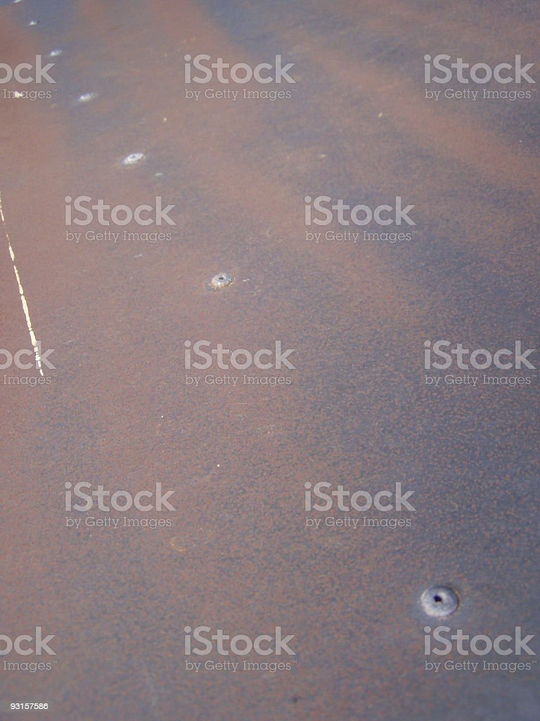 Rusty metallic floor with rivets royalty-free stock photo