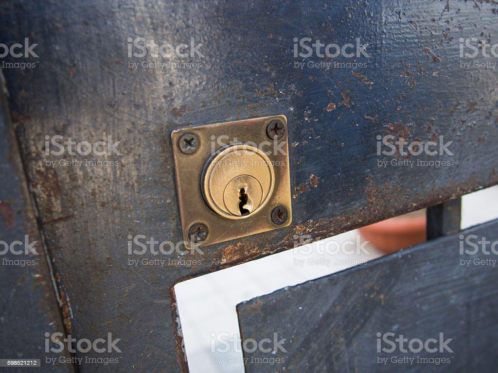 Rusty Metallic Gate with Keyhole stock photo