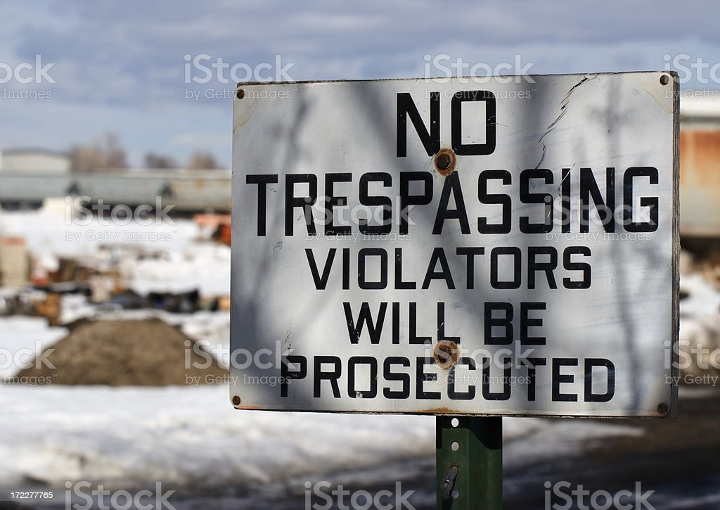Rusty No Trespassing Violators Wil Be Prosecuted Sign stock photo