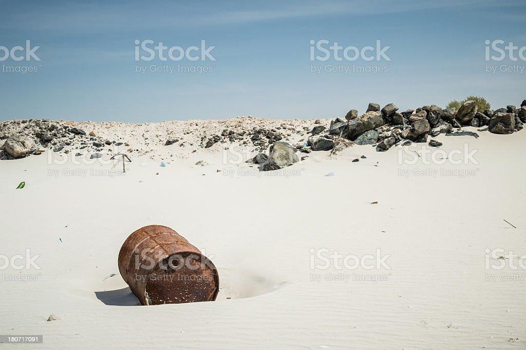 Rusty oil barrel at the beach stock photo