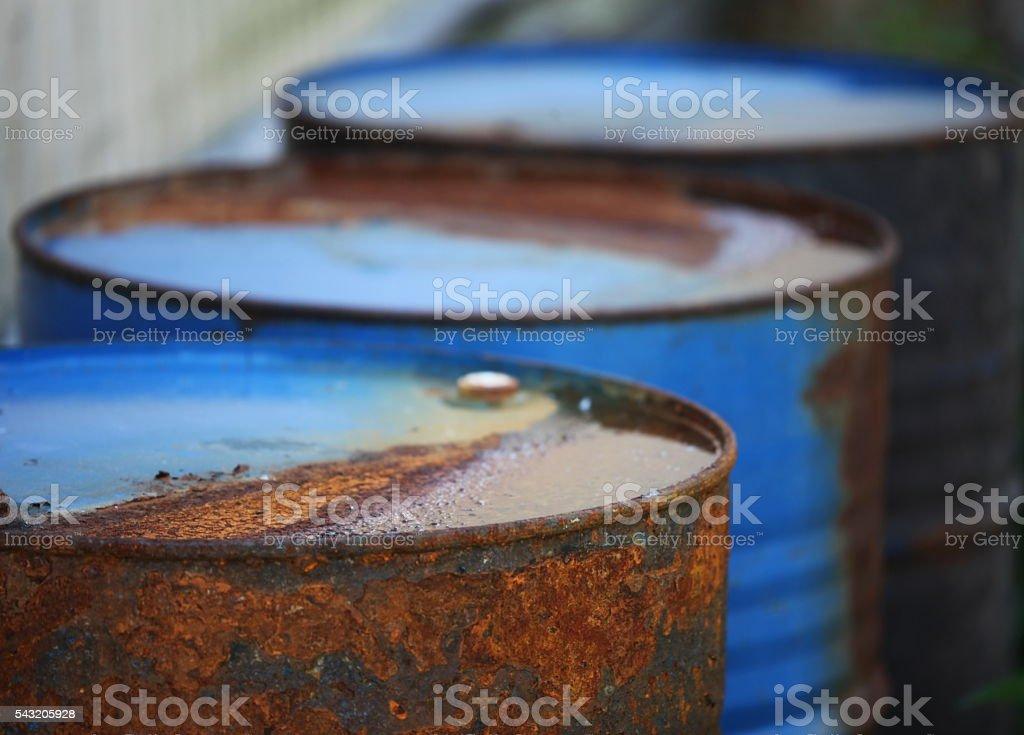 rusty oil barrels stock photo