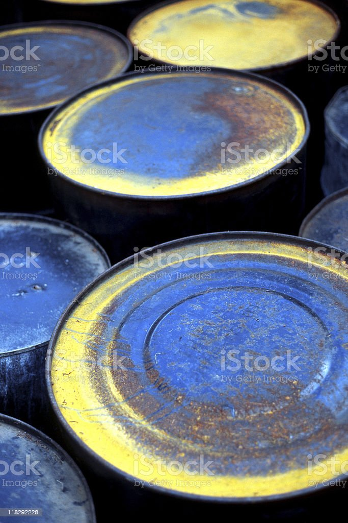 Rusty Oil Drums - Blue and Yellow Barrels royalty-free stock photo