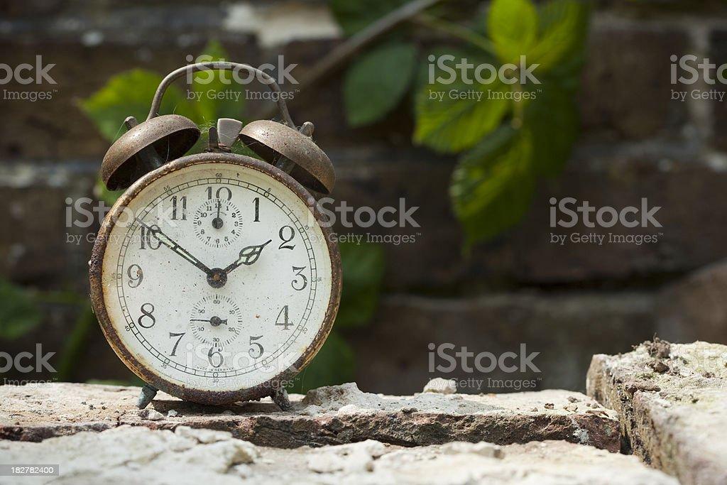 Rusty old alarm clock stock photo