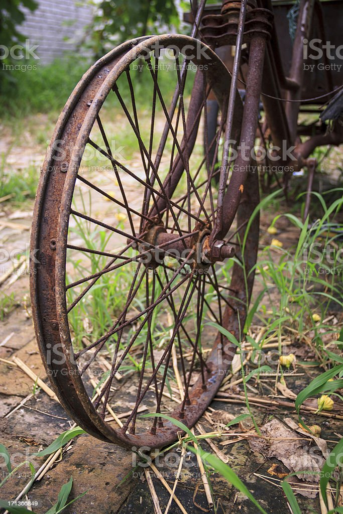 Rusty old bicycle wheel royalty-free stock photo