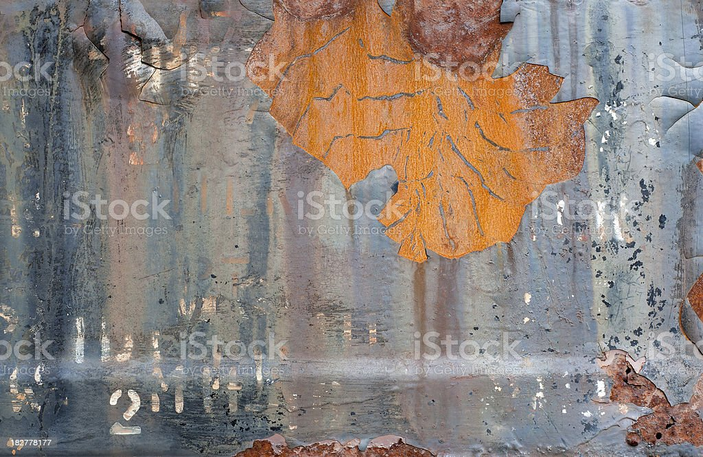 Rusty, old black-painted steel stock photo