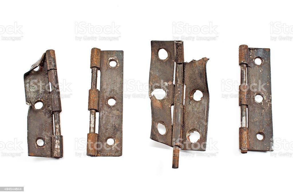 Rusty old broken door hinge isolated on white stock photo
