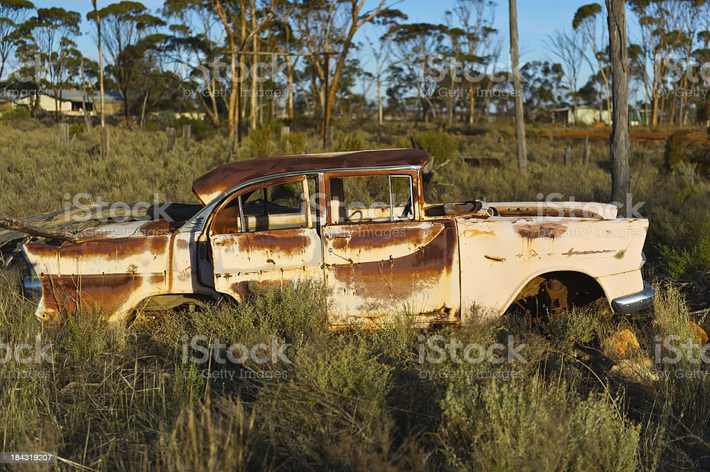 rusty old car in the bush royalty-free stock photo
