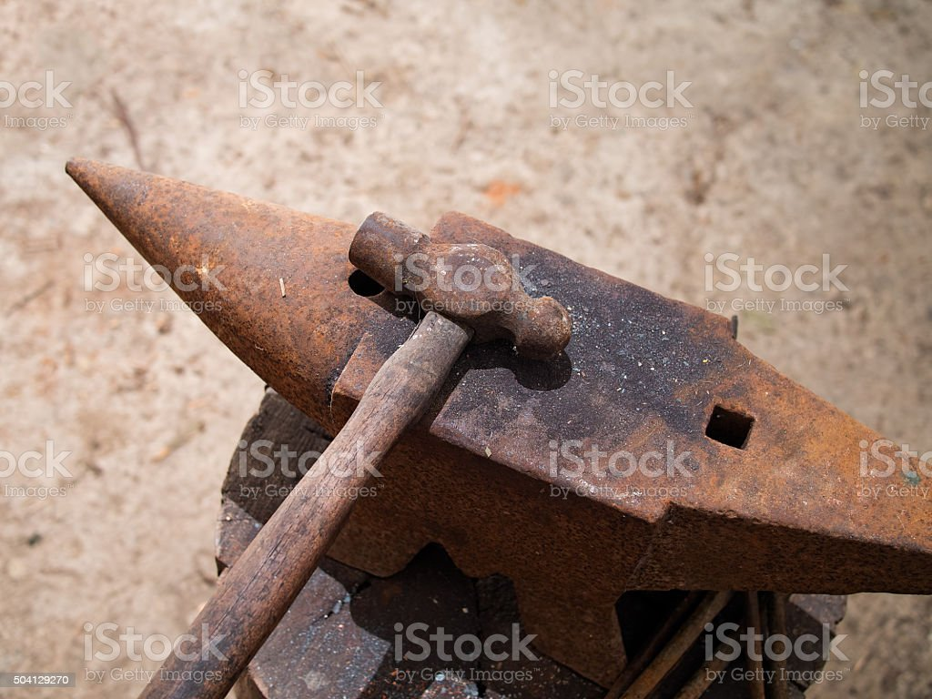 Rusty old hammer and anvil. stock photo