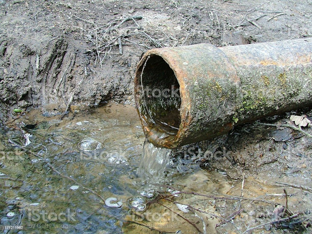 Rusty Old Iron Pipe With Clear Water Flowing From It. royalty-free stock photo