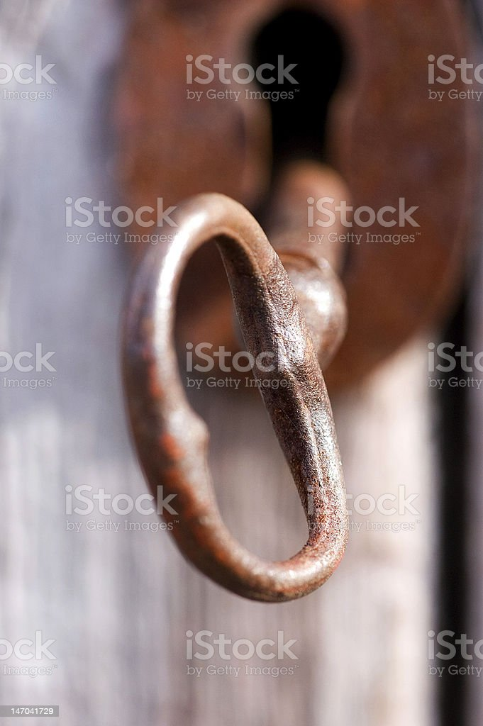 rusty old key in lock royalty-free stock photo