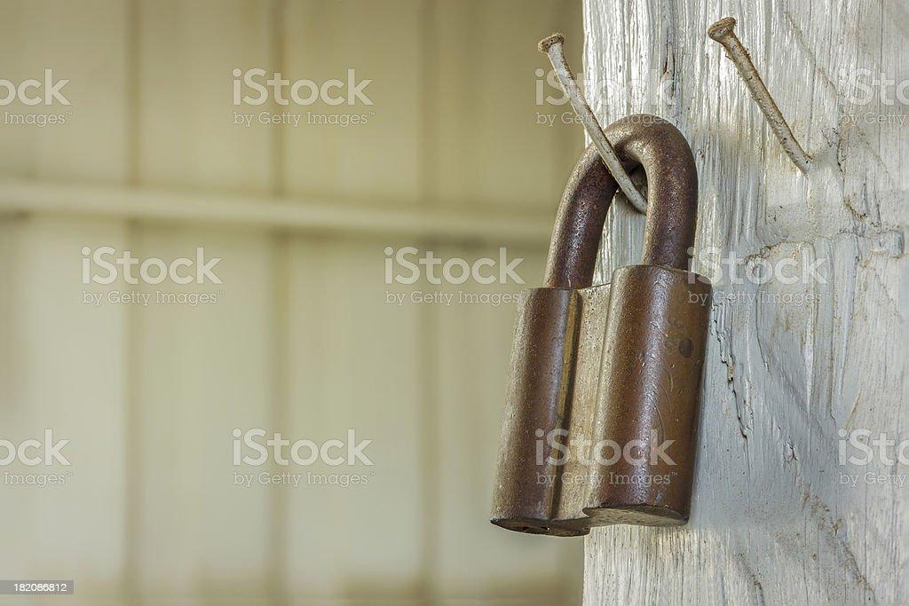 rusty old metal padlock royalty-free stock photo