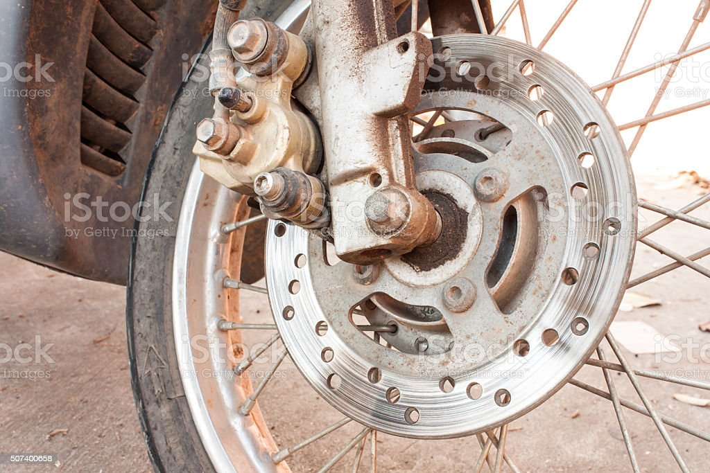 rusty old motorcycle disc brakes stock photo