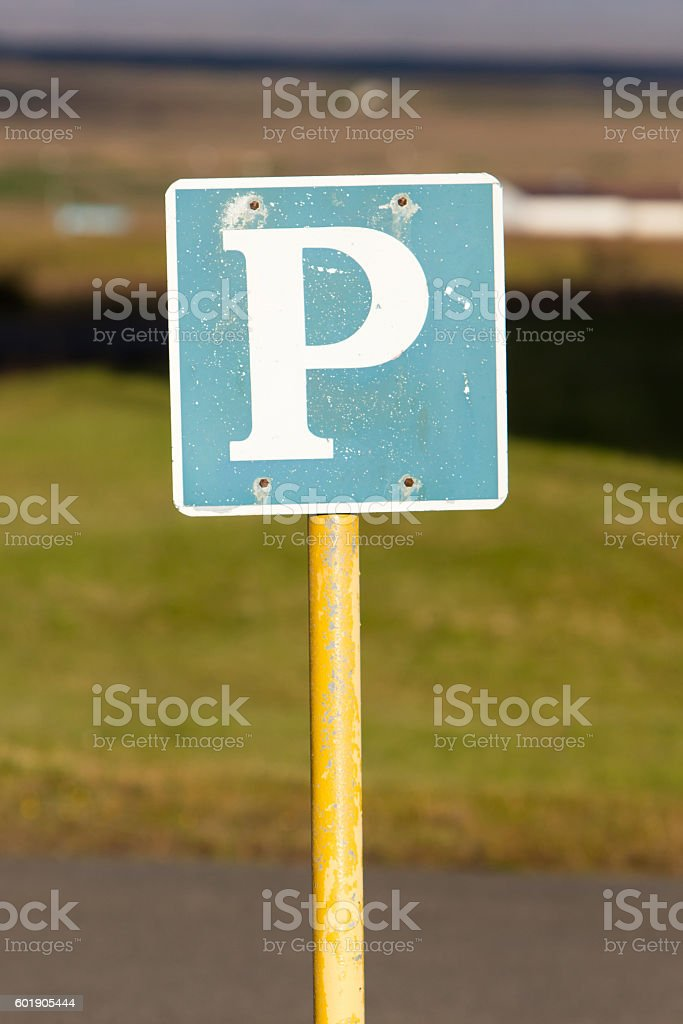 Rusty, old parking sign stock photo