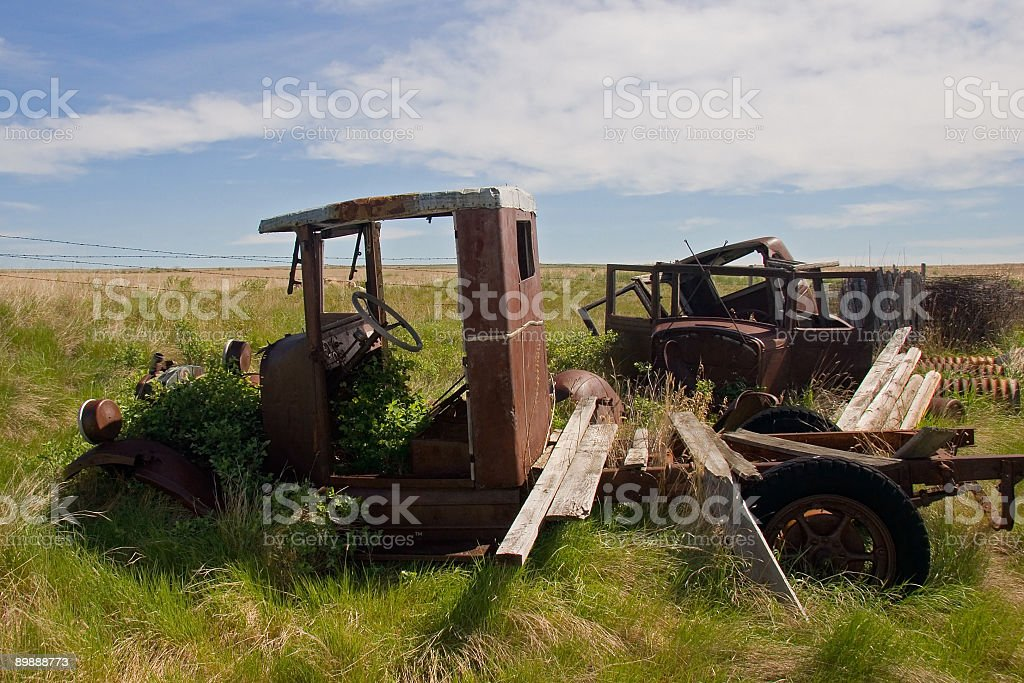 Rusty old pickup truck and some junk in a field royalty-free stock photo