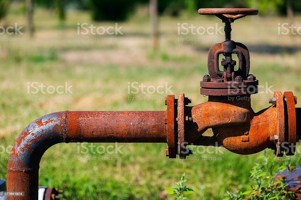 Rusty old pipeline with valve stock photo