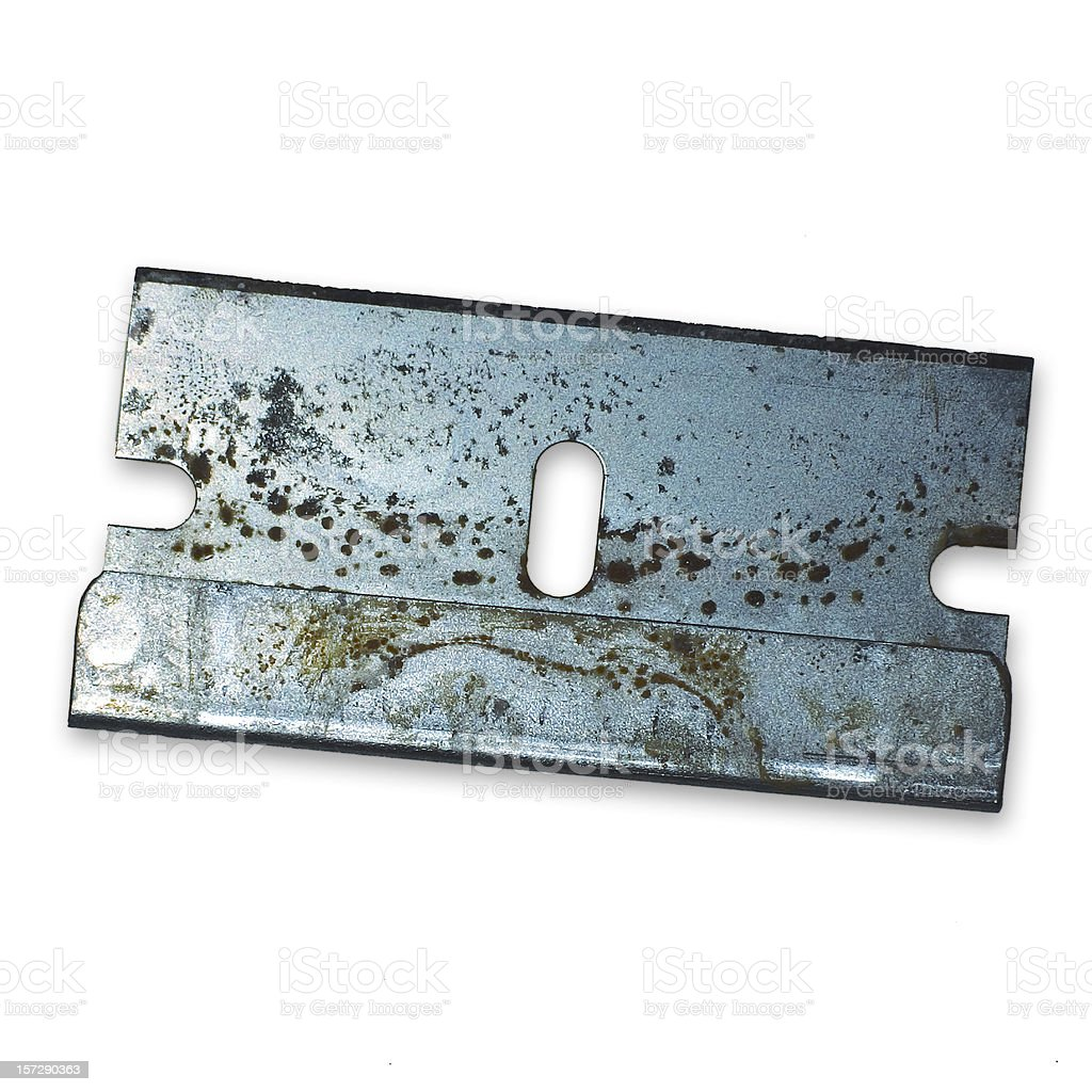 Rusty old razor blade isolated on white stock photo