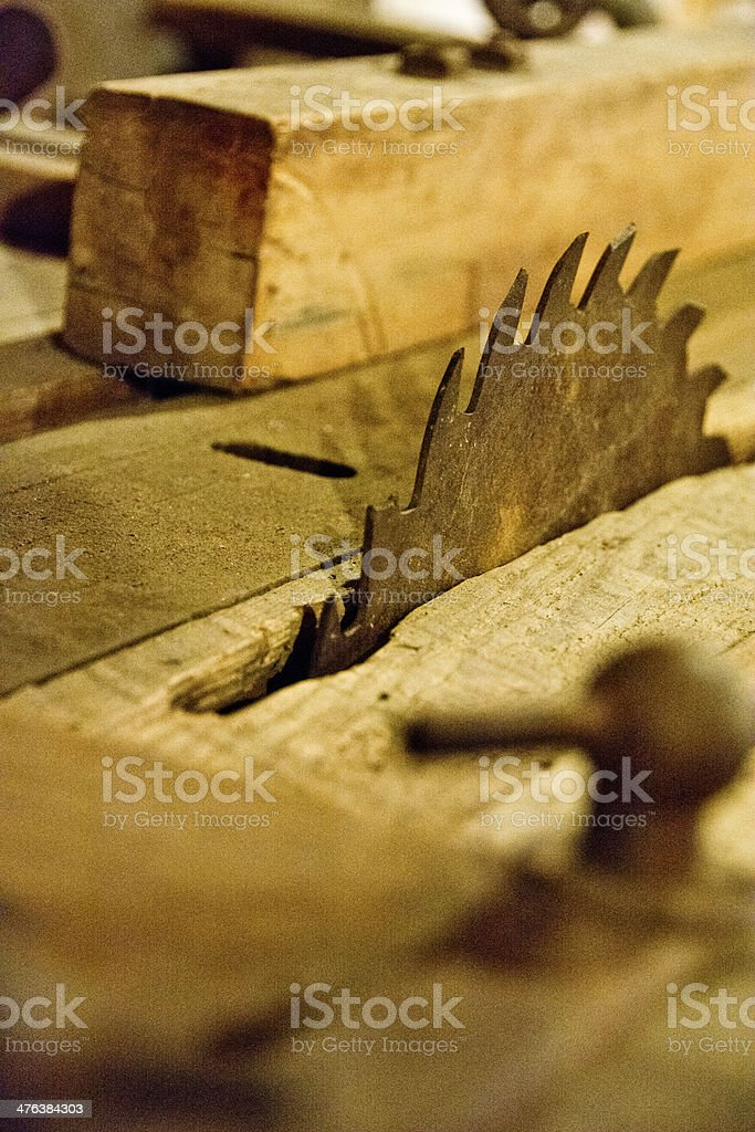 Rusty old saw blade with broken teeth royalty-free stock photo
