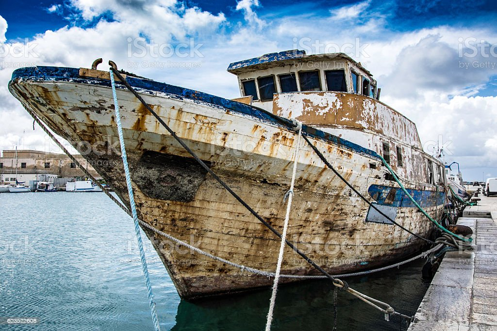 Rusty old ship at the dock Trapani stock photo