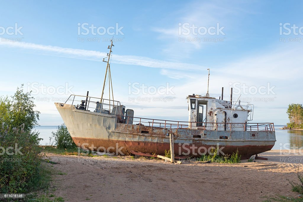 rusty old ship on the shore stock photo