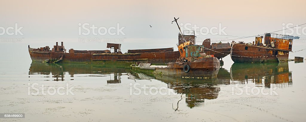 Rusty old shipwreck ruins, beach reflection, coast Sakhalin island, Russia stock photo
