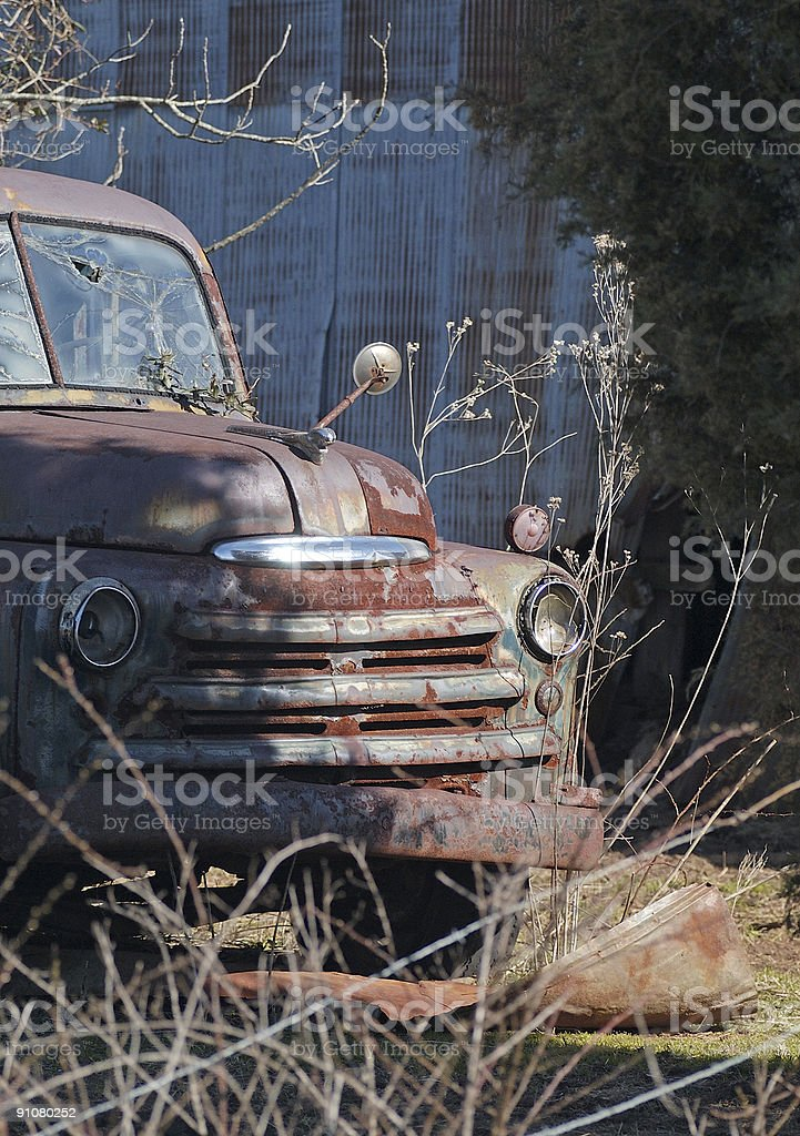 Rusty Old Truck Peeking from the Shadows royalty-free stock photo